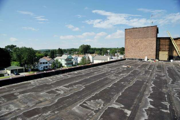 A view of the roof at the former Tilley Ladder Co. building on Wednesday, Aug. 19, 2015, in Watervliet, N.Y.  A 2,500 square-foot deck will be built on the roof.  The building is being turned into apartments.   (Paul Buckowski / Times Union) Photo: PAUL BUCKOWSKI / 00033040A