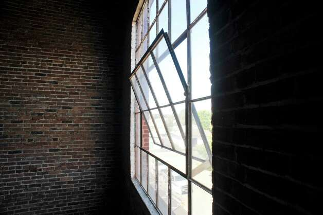 A view of the original large window in the stairwell at the former Tilley Ladder Co. building on Wednesday, Aug. 19, 2015, in Watervliet, N.Y.  The building is being turned into apartments.   (Paul Buckowski / Times Union) Photo: PAUL BUCKOWSKI / 00033040A