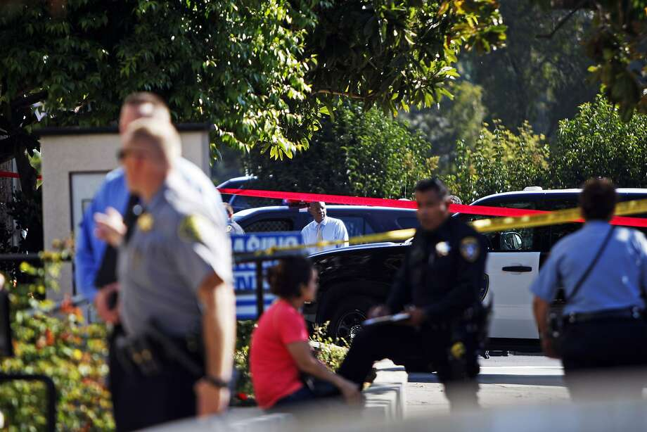 Police are seen at the scene of a police involved shooting at MacArthur Boulevard and Van Buren Avenue in Oakland, Ca. on Thursday, Aug. 27, 2015. The incident left the involved police officer in the hospital and the suspect dead at the scene. Photo: Dorothy Edwards, The Chronicle