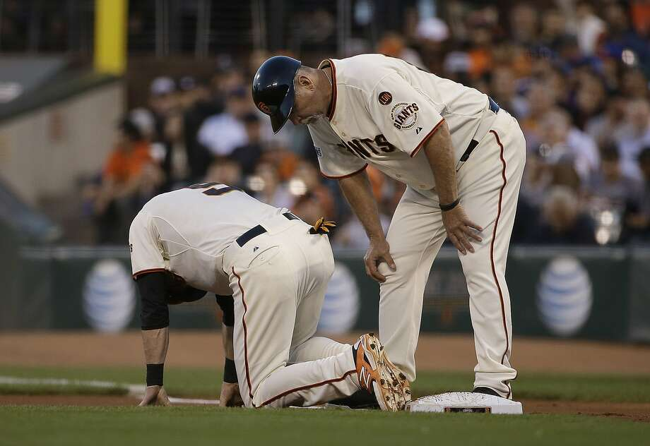 San Francisco Giants' Matt Duffy, left, is checked on by first base coach Bill Hayes against the Chicago Cubs during the first inning of a baseball game in San Francisco, Wednesday, Aug. 26, 2015. (AP Photo/Jeff Chiu) Photo: Jeff Chiu, Associated Press