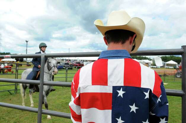 Judge John Davis, right, scores Lauryn Spiezio and her horse Luna in the trail class event during the Washington County Fair on Thursday Aug. 27, 2015 in Greenwich, N.Y. The Washington County Fair runs through Sunday. (Michael P. Farrell/Times Union) Photo: Michael P. Farrell / 10032909A