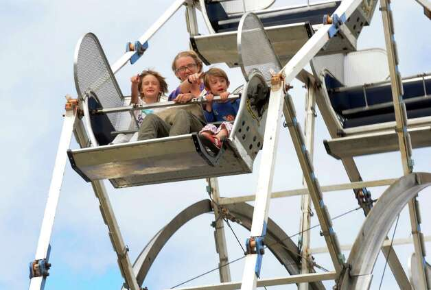Kerrigan Kessler of Cambridge rides the Ferris wheel with her children Adele and Aster Jernquist during the Washington County Fair on Thursday Aug. 27, 2015 in Greenwich, N.Y. The Washington County Fair runs through Sunday. (Michael P. Farrell/Times Union) Photo: Michael P. Farrell / 10032909A