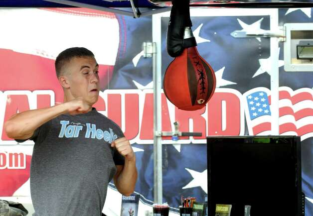 Collin Skiff of Greenwich takes aim at a punching bag at a National Guard booth during the Washington County Fair on Thursday, Aug. 27, 2015, in Greenwich, N.Y. The fair runs trough Sunday. (Michael P. Farrell/Times Union) Photo: Michael P. Farrell / 10032909A