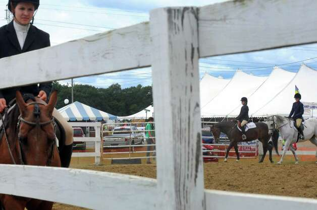 Riders compete in the English pleasure portion of the riding competition during the Washington County Fair on Thursday Aug. 27, 2015 in Greenwich, N.Y. The Washington County Fair runs through Sunday. (Michael P. Farrell/Times Union) Photo: Michael P. Farrell / 10032909A