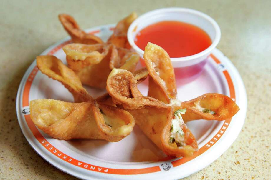 Cream Cheese Rangoon with sweet and sour sauce on Friday, Aug. 21, 2015, at the Panda Express in Latham, N.Y. (Cindy Schultz / Times Union) Photo: Cindy Schultz / 00033076A