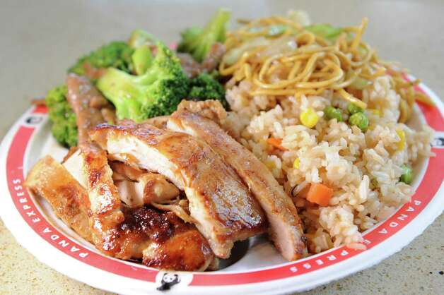 Bigger Plate order with grilled Teriyaki chicken, broccoli beef, chow mien and fried rice on Friday, Aug. 21, 2015, at the Panda Express in Latham, N.Y. (Cindy Schultz / Times Union) Photo: Cindy Schultz / 00033076A