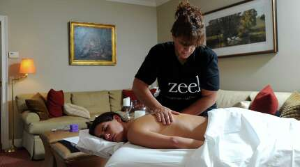 Zeel Massage therapist, Susan Pomarico, makes a home visit as she gives a massage to client Charlotte Dewey at Dewey's home in Greenwich, Conn., Tuesday night, Aug. 25, 2015. Zeel is a new Massage-on-Demand company in Fairfield County.