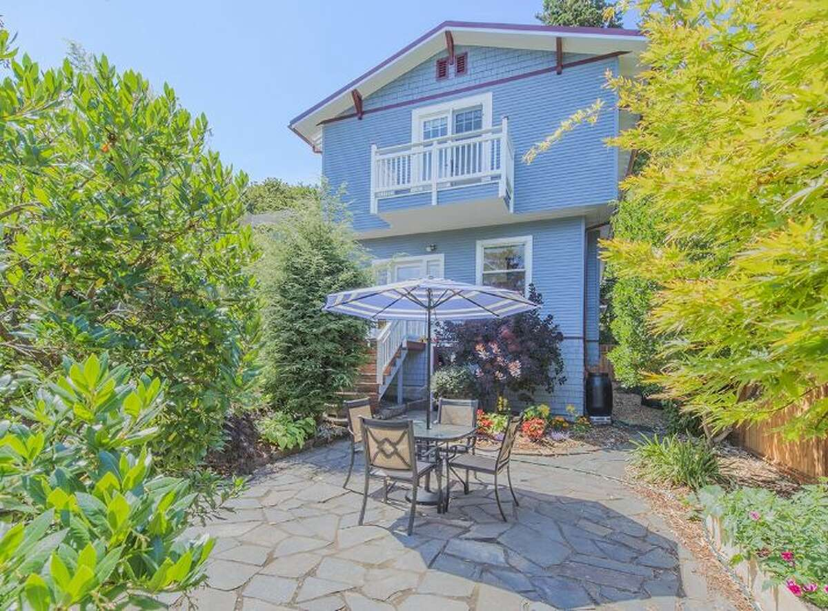 A stone patio surrounded by lush trees and bushes at 3836 36th Ave. W in the Magnolia area. This 4-bedroom, 2 1/2-bath home lists for $880,000 and can be seen from 1-4 p.m. this Saturday and Sunday. You can read the full listing here.