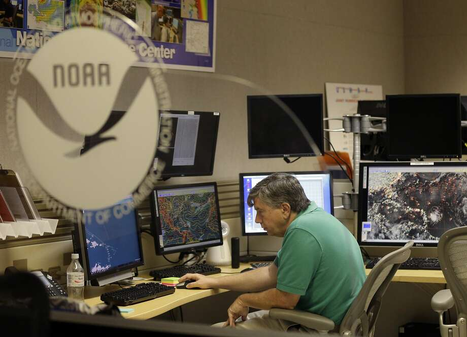 Jack Beven, senior hurricane specialist at the National Hurricane Center, tracks the movement of Tropical Storm Erika as it moves westward toward islands in the eastern Caribbean. Photo: Lynne Sladky, Associated Press