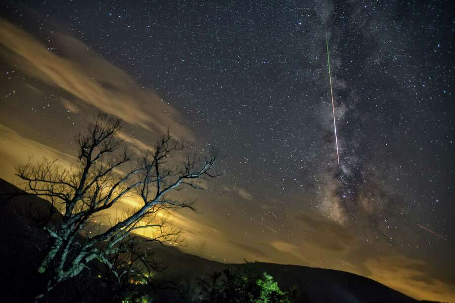 The Perseid meteor shower is shown at Shenandoah National Park. Harun Mehmedinovic and Gavin Heffernan used timelapse photography to bring attention to light pollution in the night skies as part of their SKYGLOW project. Photo: Harun Mehmedinovic And Gavin Hefferman/Courtesy