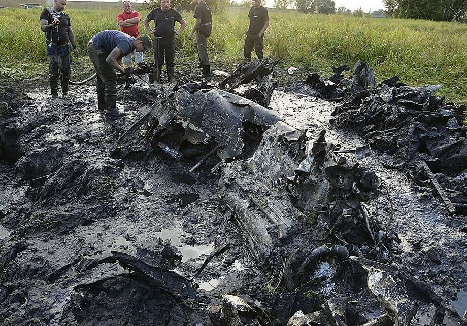 The remains of a Soviet WWII fighter-bomber were found in riverbed near Wyszogrod, Poland, after the nation's drought dried up a portion of the Vistula River. Photo: Str, Associated Press