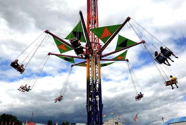 The Vertigo ride set against a cloud-filled sky during the Washington County Fair on Thursday Aug. 27, 2015 in Greenwich, N.Y. The Washington County Fair runs through Sunday. (Michael P. Farrell/Times Union) Photo: Michael P. Farrell / 10032909A