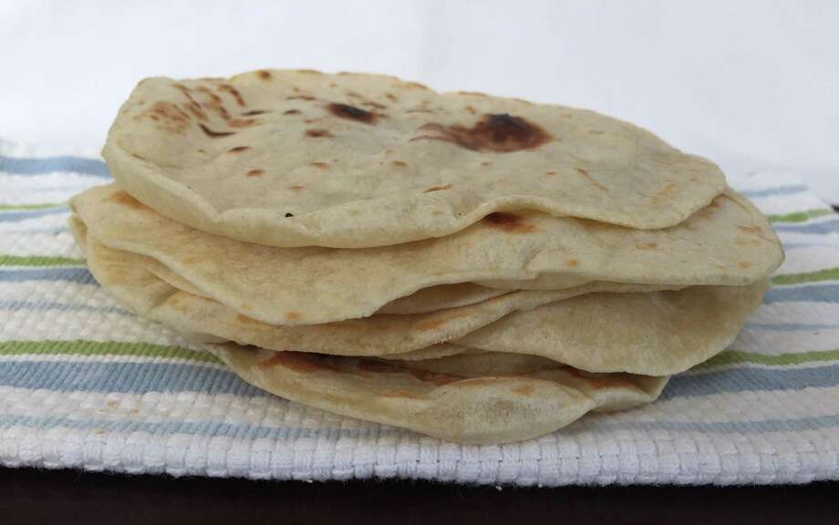 Flour tortillas from a family recipe of Estella Tijerina. Tortilla recipes vary from northern Mexico to South Texas, the main difference being baking powder. Photo: Photos By Edmund Tijerina / San Antonio Express-News