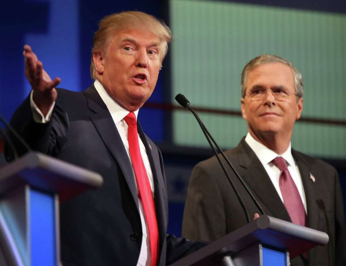 Republican presidential candidate Donald Trump speaks as Jeb Bush listens during the first Republican presidential debate, at the Quicken Loans Arena in Cleveland on Aug. 6.
