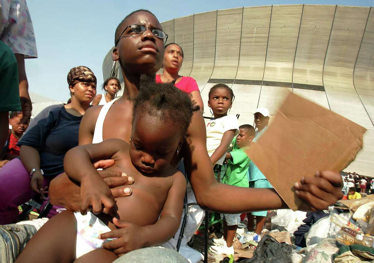 Ten years ago Hurricane Katrina slammed into the coast near New Orleans. What followed was one of the worst humanitarian disasters in U.S. history. This collection shows the calamity that ensued in the days after landfall. Shown: Stranded victims of Hurricane Katrina wait outside the Superdome to be evacuated.