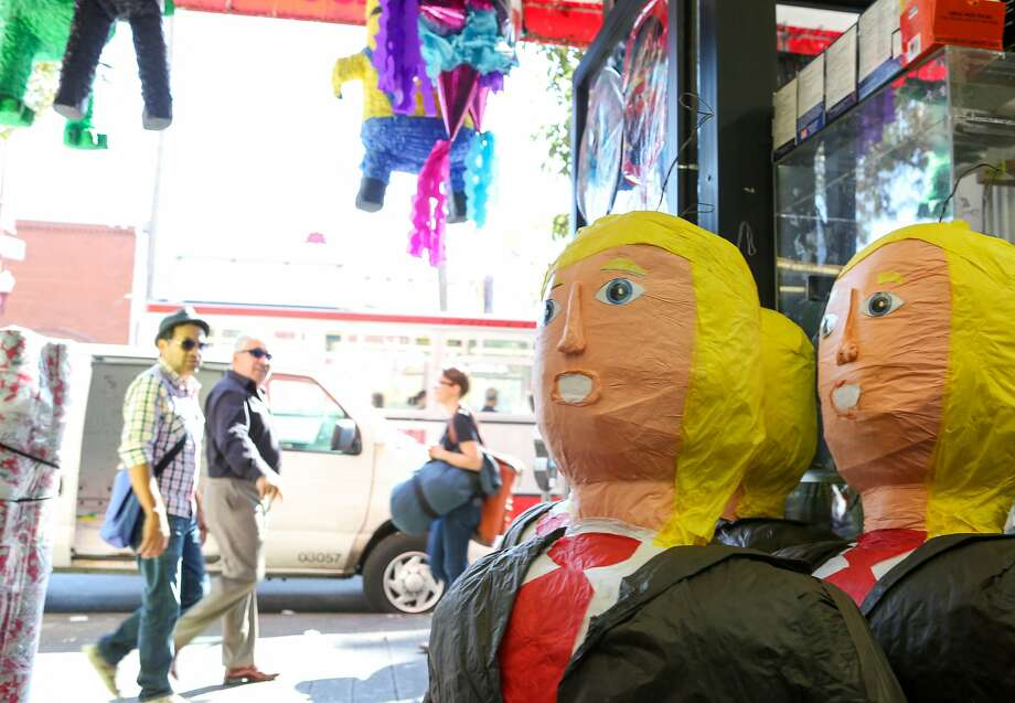 People walking past Discount City Store on Mission Street  can't help but look at the large Donald Trump pinatas displayed there on Thursday, August 27. 2015 in San Francisco, Calif. Photo: Amy Osborne, Special To The Chronicle