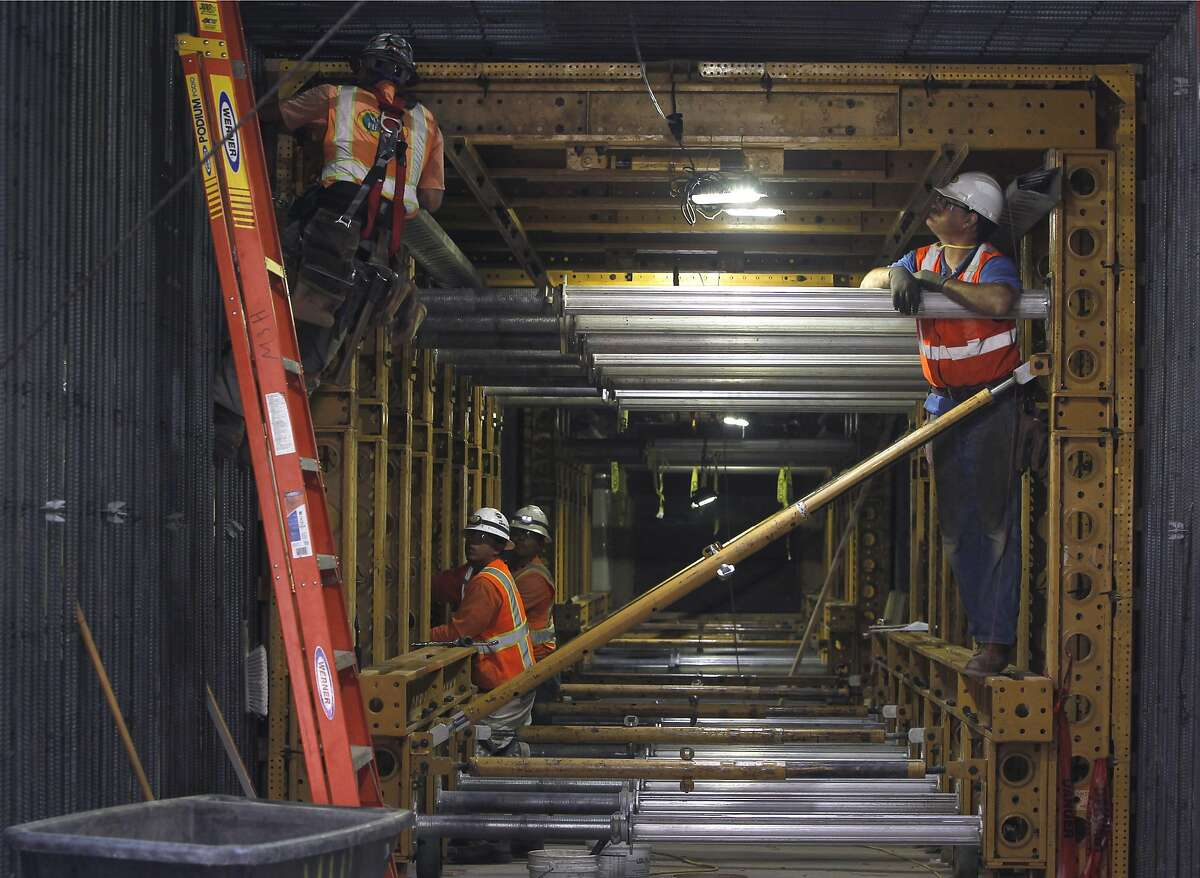 A construction crew works inside the pedestrian tunnel below Van Ness Avenue for the California Pacific Medical Center hospital project in San Francisco, Calif. on Thursday, Aug. 27, 2015. Structural engineers are bolting 119 viscous wall dampers in the exterior walls to minimize or eliminate damage during a major earthquake.