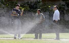 (l to r) Water auditor with the Marin Municipal Water District, Craig Lauridsn, meets with landscaper Vince Gray of Trugreen Landscaping Vince Gray and Acqua Hotel  general manager Justin Flake, as they monitor the water flow to sprinklers at the Acqua Hotel, in Mill Valley, Calif. as seen on Thurs. August 27, 2015.