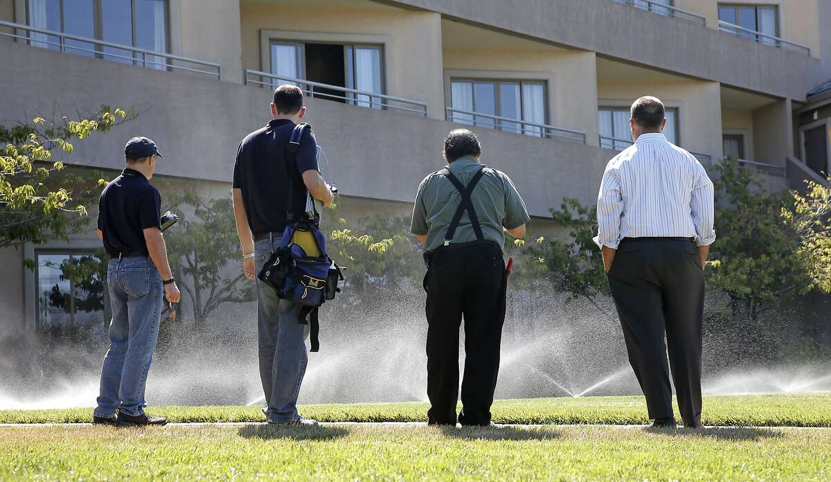( l to r) Water auditors from the Marin Municipal Water District, Sergio Paganelli, Craig Lauridsen, meet with Trugreen landscaper Vince Gray and Acqua Hotel general manager Justin Flake, (right) as they monitor the water flow to sprinklers on the landscaping at the Acqua Hotel, in Mill Valley, Calif. as seen on Thurs. August 27, 2015.