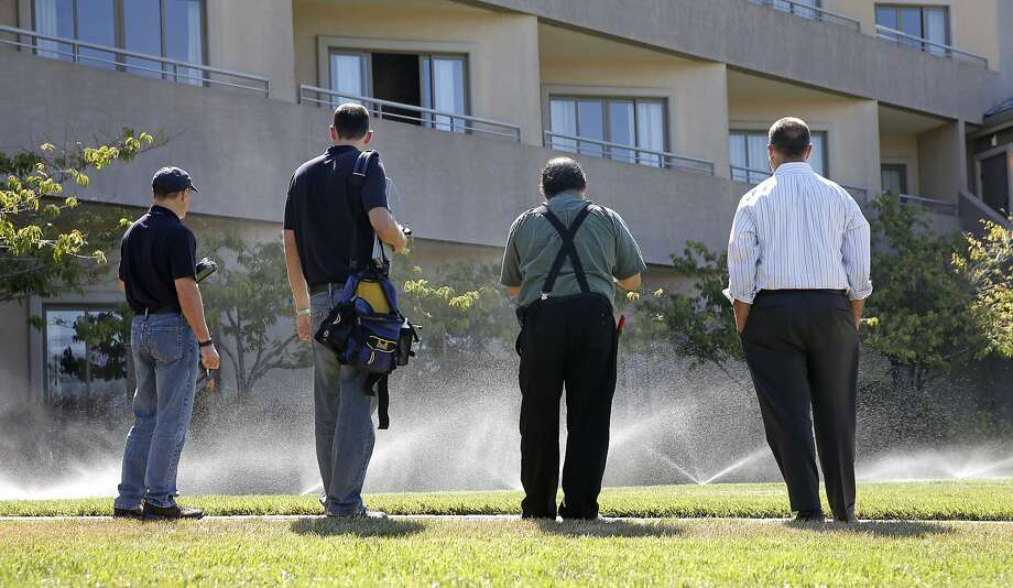 ( l to r) Water auditors from the Marin Municipal Water District, Sergio Paganelli, Craig Lauridsen, meet with Trugreen landscaper Vince Gray and Acqua Hotel general manager Justin Flake, (right) as they monitor the water flow to sprinklers on the landscaping at the Acqua Hotel, in Mill Valley, Calif. as seen on Thurs. August 27, 2015. Photo: Michael Macor, The Chronicle