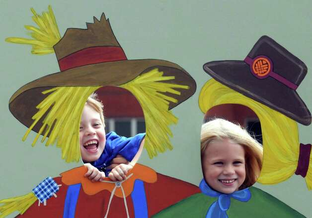 """Noah, left, and Kaleigh Mackey of East Greenbush have fun with a scarecrow cutout during the """"We're All Ears Cornival,"""" a corn-themed chefs'competition to raise money for the Regional Food Bank of Northeastern New York at SEFCU's outer parking lot on Thursday Aug. 27, 2015 in Albany, N.Y. (Michael P. Farrell/Times Union) Photo: Michael P. Farrell / 00033144A"""