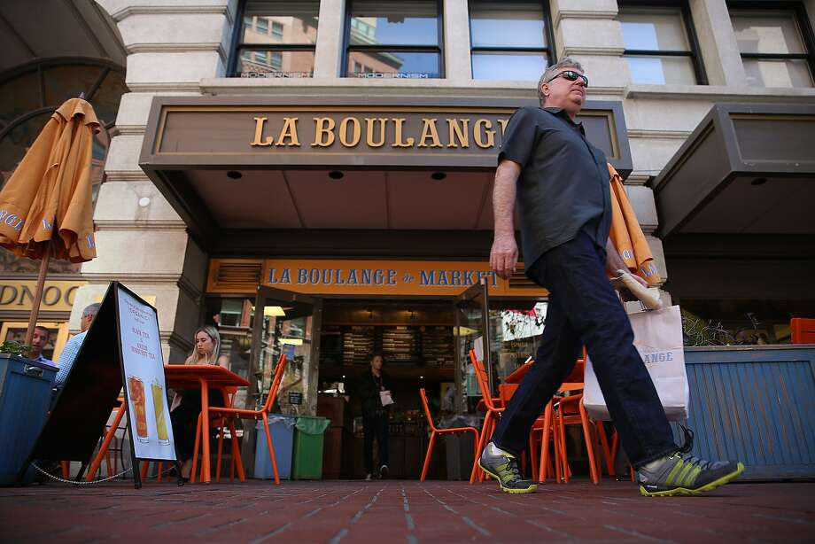 Shannon Trimble (right) from San Francisco buys his last loaves of bread at La Boulange on the ground floor of the Monadnock building on Market St. in San Francisco, Calif., on Thursday, August 27, 2015. Photo: Liz Hafalia, The Chronicle
