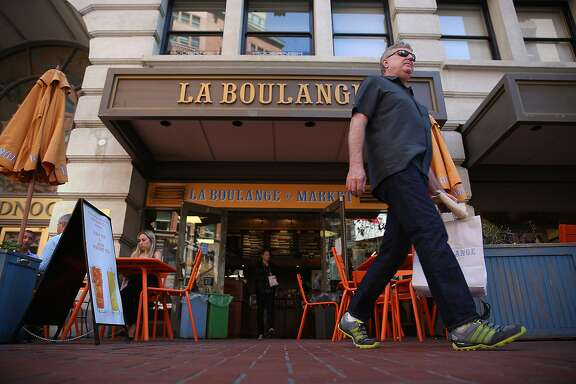 Shannon Trimble (right) from San Francisco buys his last loaves of bread at La Boulange on the ground floor of the Monadnock building on Market St. in San Francisco, Calif., on Thursday, August 27, 2015.