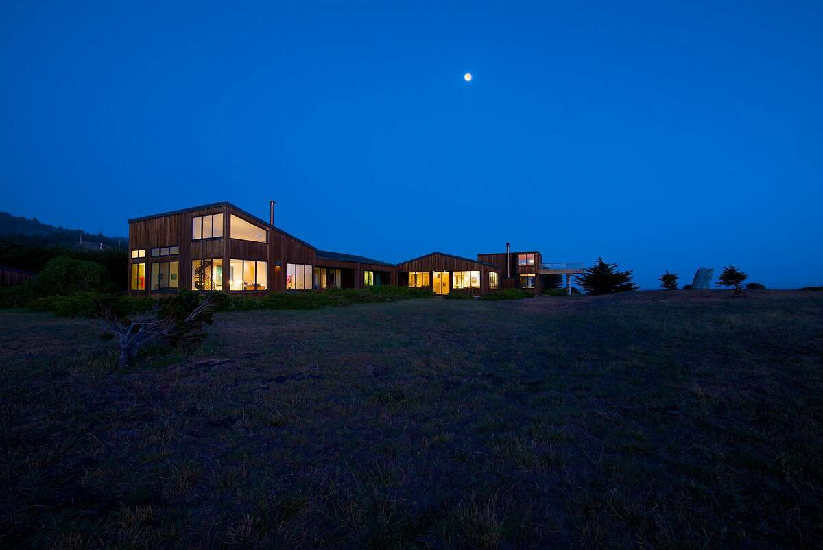 The four-bedroom contemporary sits on 21 acres with ocean views.