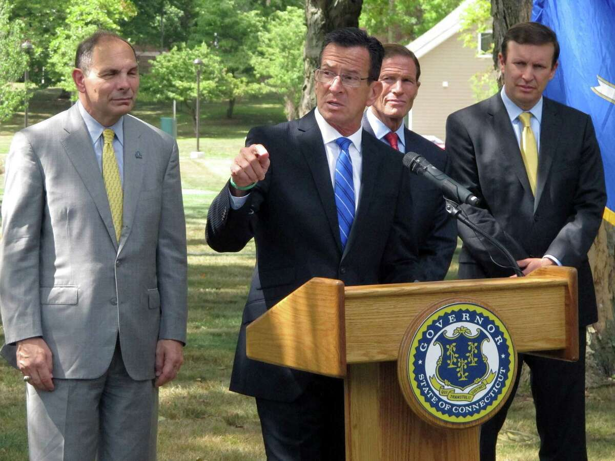 Connecticut Gov. Dannel P. Malloy speaks at a news conference at a veterans' housing development Thursday, Aug. 27, 2015, in Newington, Conn. Behind him from left are U.S. Veterans Affairs Secretary Robert McDonald and U.S. Senators Richard Blumenthal and Chris Murphy. Malloy announced that Connecticut is the first state in the country to end chronic homelessness among veterans.