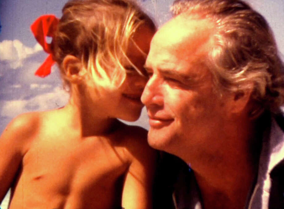 "Marlon Brando and his daughter Cheyenne, in an archival still from the documentary ""Listen To Me Marlon."" Illustrates FILM-MARLON-ADV14 (category e), by Jen Chaney, special to The Washington Post. Moved Wednesday, Aug. 12, 2015. (MUST CREDIT: Mike Gillman/Courtesy of Showtime.) Photo: HANDOUT / THE WASHINGTON POST"