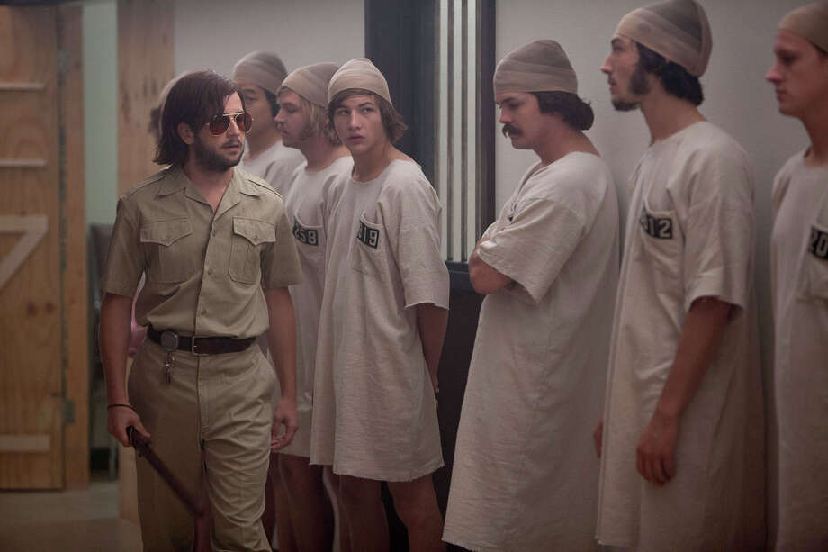 "Christopher Archer (Michael Angarano), left, draws guard duty in ""The Stanford Prison Experiment"" as many of his fellow study participants, all male Stanford students, became prisoners. Illlustrates FILM-STANFORD (category e), by Ann Hornaday© 2015, The Washington Post. Moved Thursday, July 30, 2015. (MUST CREDIT: Steve Dietls/IFC Films.) Photo: HANDOUT / THE WASHINGTON POST"