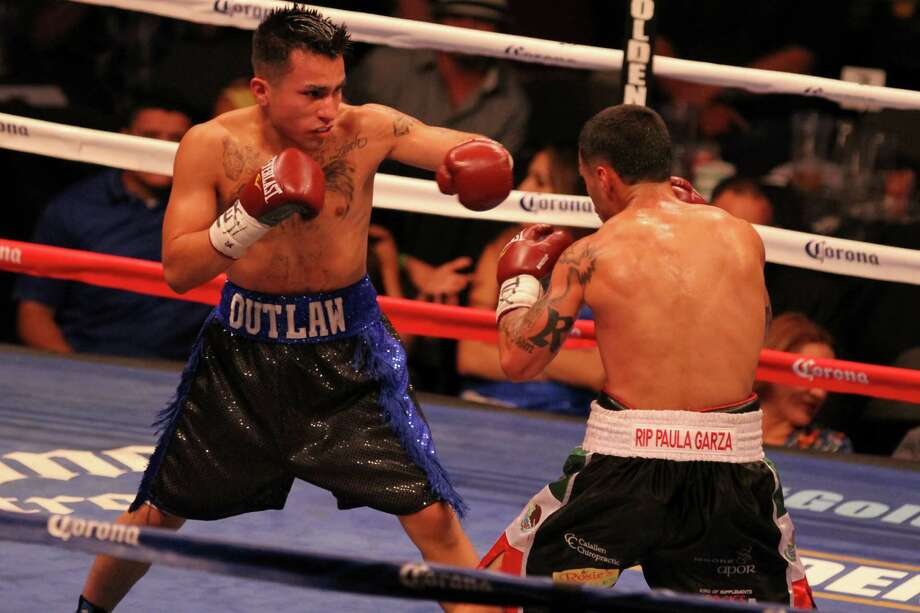 Junior lightweight Jesse Anguiano of San Antonio (left) faces Robert Vela (of Robstown in a six-round bout on Aug. 7, 2014, at the American Bank Center in Corpus Christi. The match resulted in a split decision. Photo: Micah DeBenedetto /Courtesy Photo / Micah DeBenedetto
