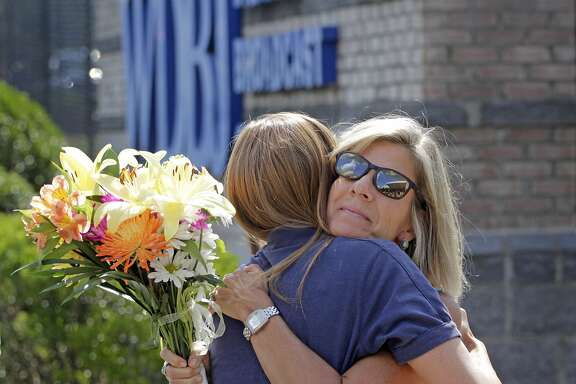 ROANOKE, VA - AUGUST 27: WDBJ employee, Karen Loftus gets a hug from Donna Anderson, whose daughter works at the station after a press conference about the two journalists that were killed on August 27, 2015 in Roanoke, Virginia. Two employees of WDBJ TV were killed during a live broadcast at Bridgewater Plaza on Smith Mountain Lake on August 26. The victims have been identified as reporter Alison Parker and camerman Adam Ward. Parker, 24 and Ward, 27, worked for WDBJ in Roanoke, Virginia. The suspect, Vester Lee Flanigan, also known as Bryce Williams, died of a self-inflicted gunshot wound. (Photo by Jay Paul/Getty Images)