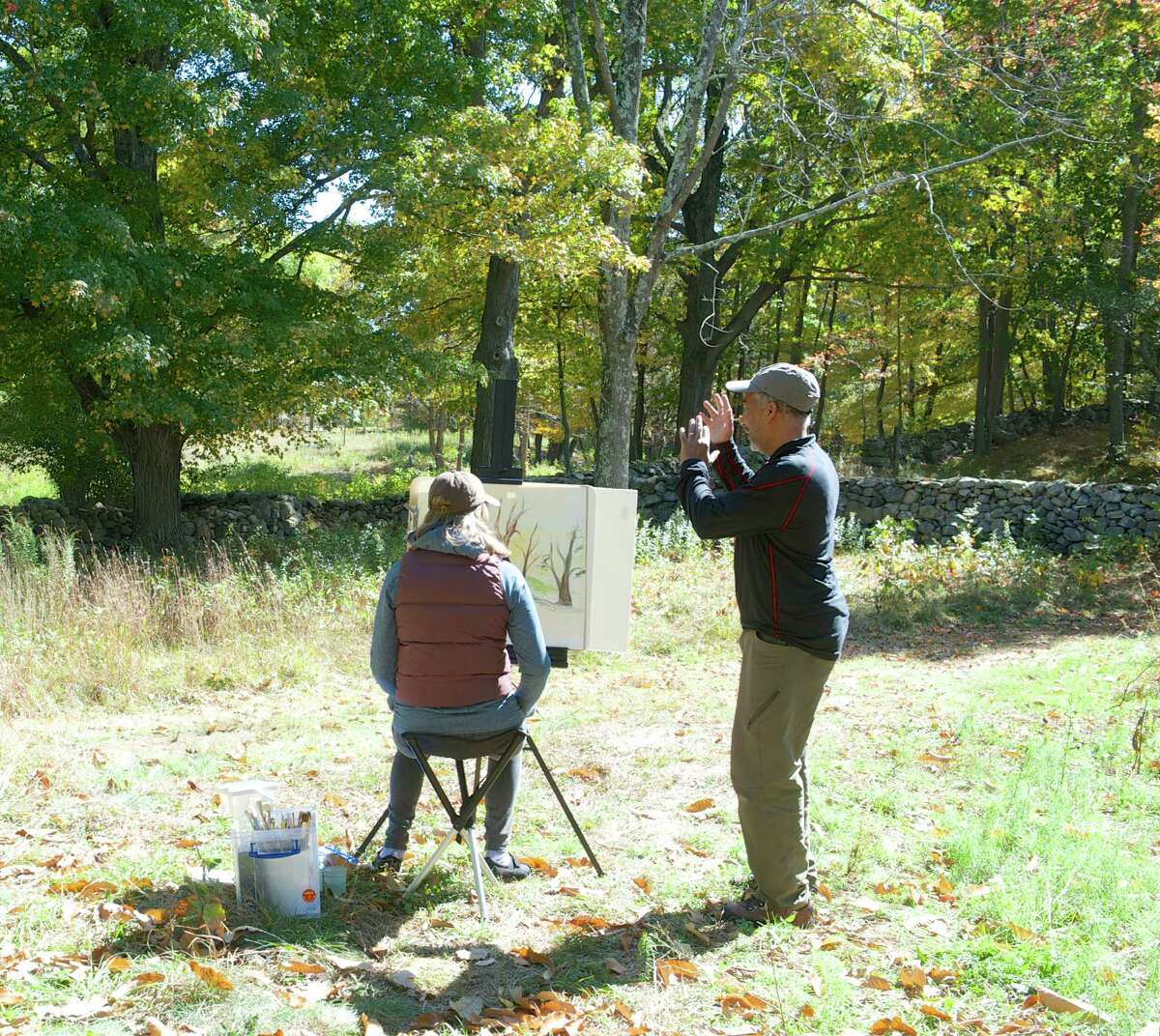 Dmitri Wright, right, a Greenwich artist, works with Donna Gagliardi, an art teacher at Shelter Rock and Great Plain elementary schools in Danbury, during a fall workshop at Weir Farm National Historic Site in Wilton in 2014. Wright's Weir Farm Art Academy will run at the site in October.