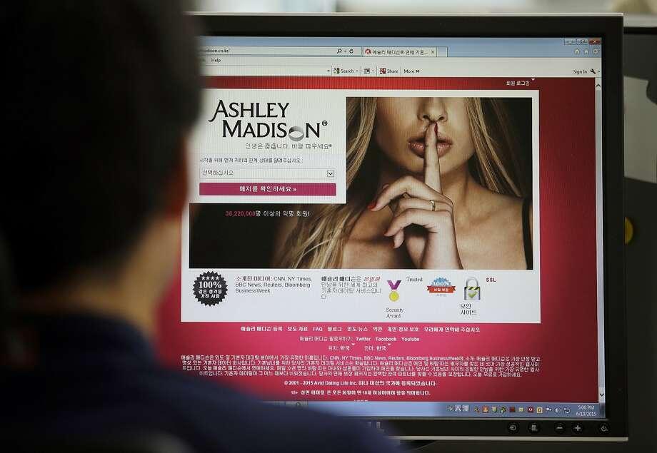 A June 10, 2015 file photo shows Ashley Madison's Korean web site on a computer screen in Seoul, South Korea. Photo: Lee Jin-man, Associated Press