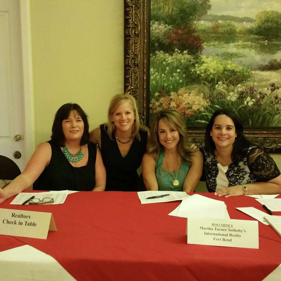 Realtor DeeAnn Gates, MTSIR sales manager Robin Connor, Realtors AJ Whitener and Yamilia Halfon were at the HAR luncheon hosted by Martha Turner SIR's Fort Bend office at Sweetwater Country Club.