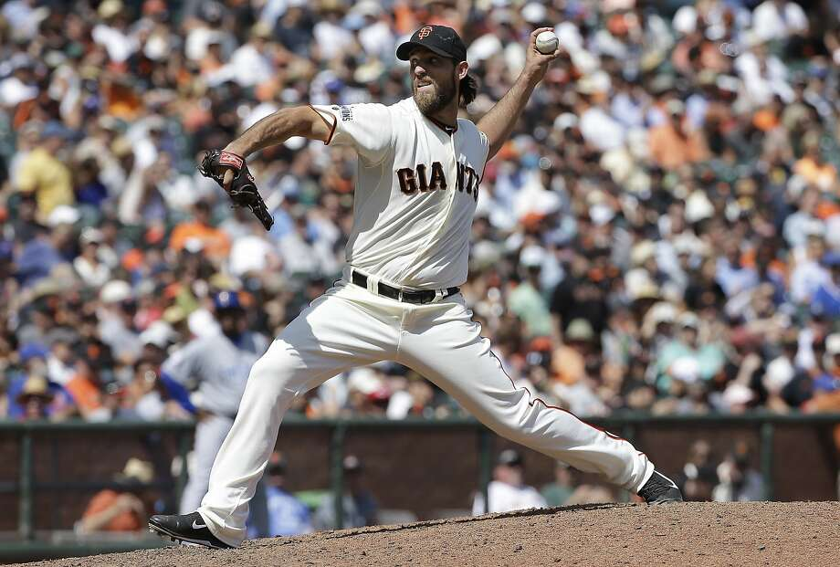 Madison Bumgarner joined Chicago's Jake Arrieta as the only 16-game winners in the majors. Photo: Jeff Chiu, Associated Press