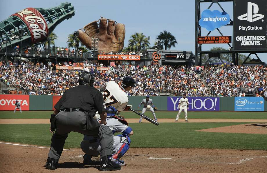 San Francisco Giants' Kelby Tomlinson hits a grand slam home run against the Chicago Cubs during the eighth inning of a baseball game in San Francisco, Thursday, Aug. 27, 2015. The Giants won 9-1. Photo: Jeff Chiu, Associated Press
