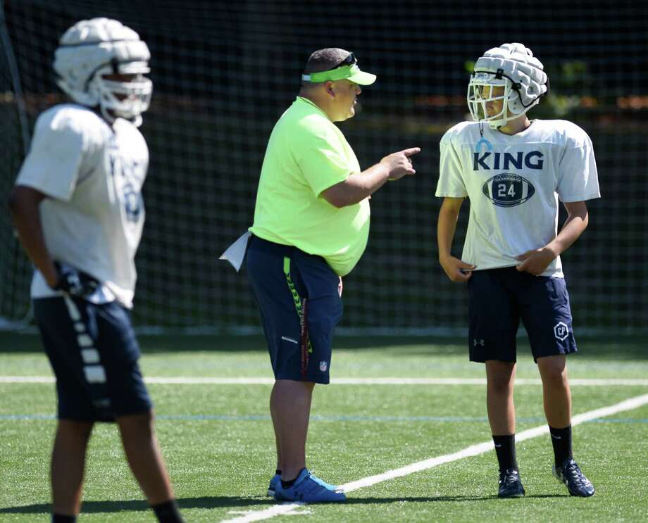 Head coach Danny Gouin talks to his players during football practice at King School in Stamford, Conn. Thursday, Aug. 27, 2015. Photo: Tyler Sizemore / Hearst Connecticut Media / Greenwich Time