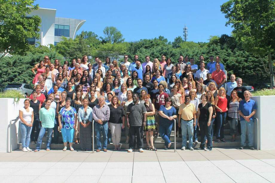 American Institute for Foreign Study employees in front of the company's offices at 1 High Ridge Park in Stamford. Photo: Contributed / Contributed Photo / Stamford Advocate  contributed