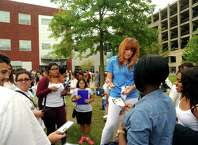 Samantha Kent, an orientation leader from Trumbull, works with incoming students during orientation day at Housatonic Community College in Bridgeport on Thursday. Kent is a psychology major at HCC. Classes start Monday.
