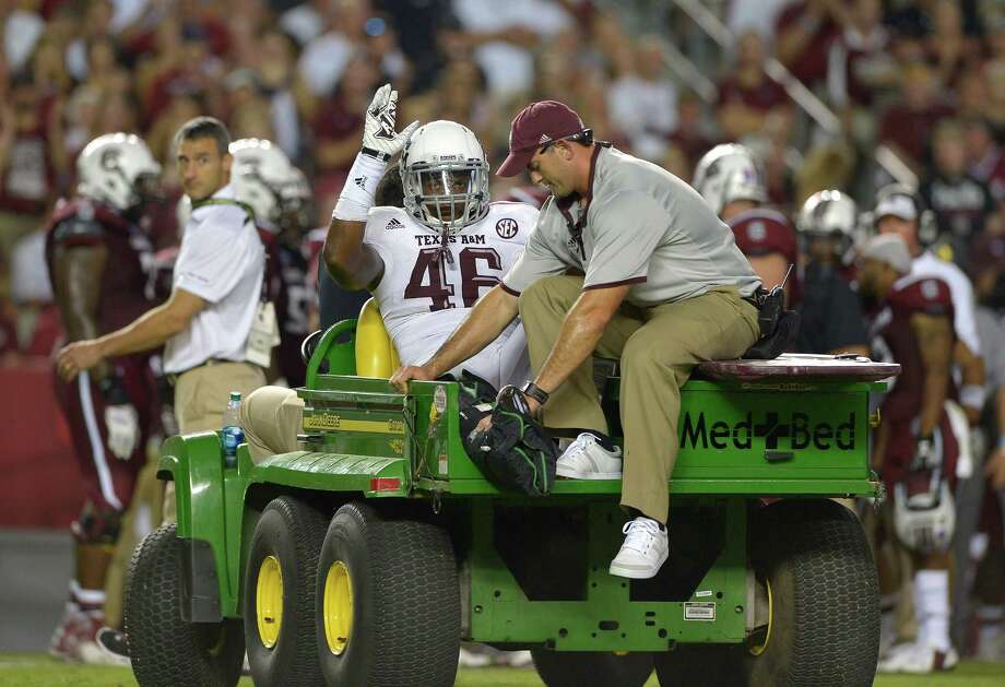 A.J. Hilliard of the Texas A&M Aggies waves to the fans as he leaves the field with a leg injury during a game against the South Carolina Gamecocks at Williams-Brice Stadium on Aug. 28, 2014 in Columbia, South Carolina. Texas A&M won 52-28. Photo: Grant Halverson /Getty Images / 2014 Getty Images