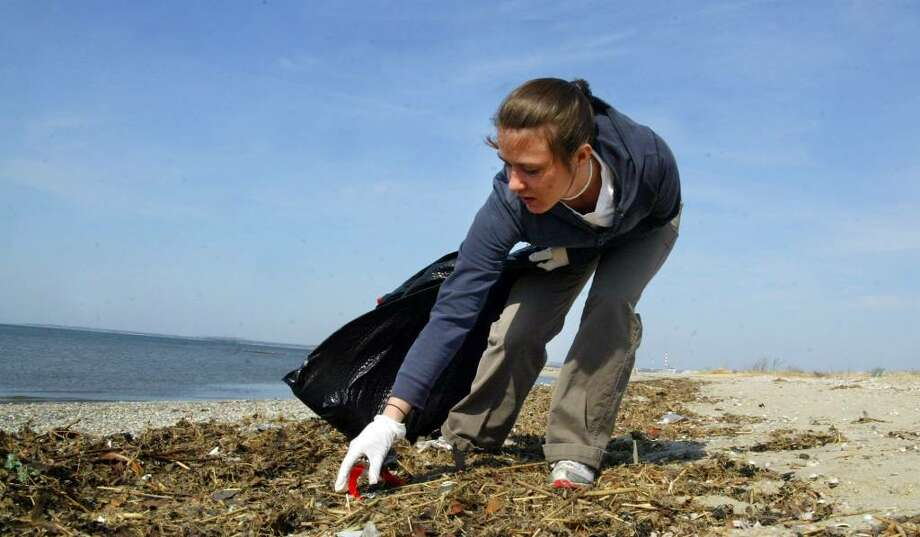 Melissa Chingo, of Hamden, picks up trash along Long Beach in Stratford, Sunday, March 21, 2010. Chingo was taking part in the 2010 Beach Week Clean Up sponsored by Connecticut Community Boating. Photo: Phil Noel / Connecticut Post