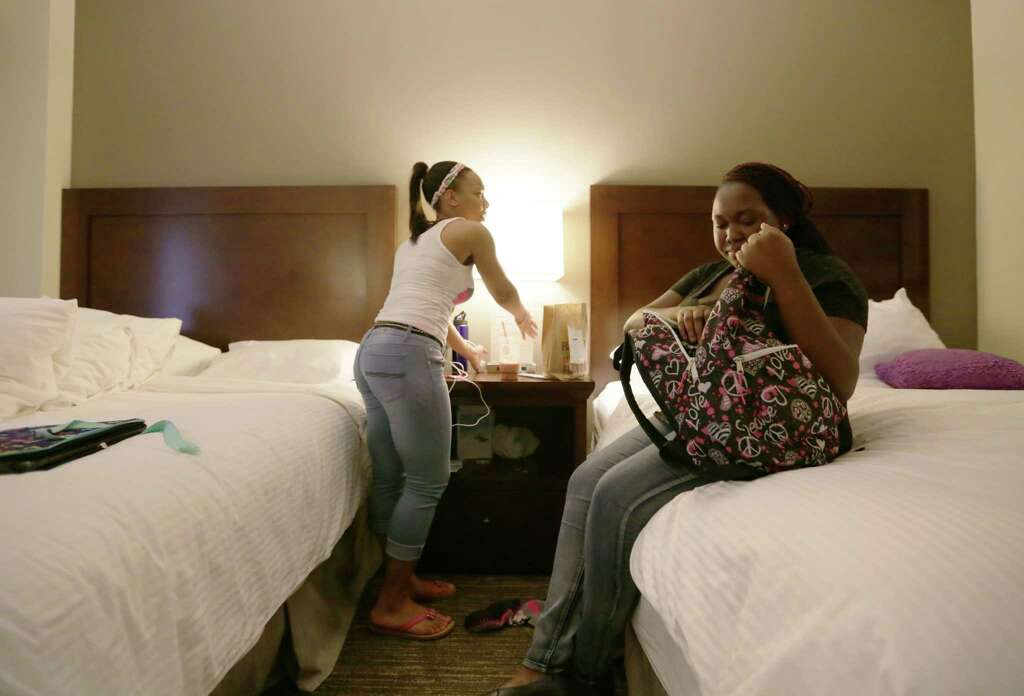 Latanya Rozier And Ranesha Ferguson Unpack Their Belongings After Arriving  At The Wyndam   Houston Medical Part 2