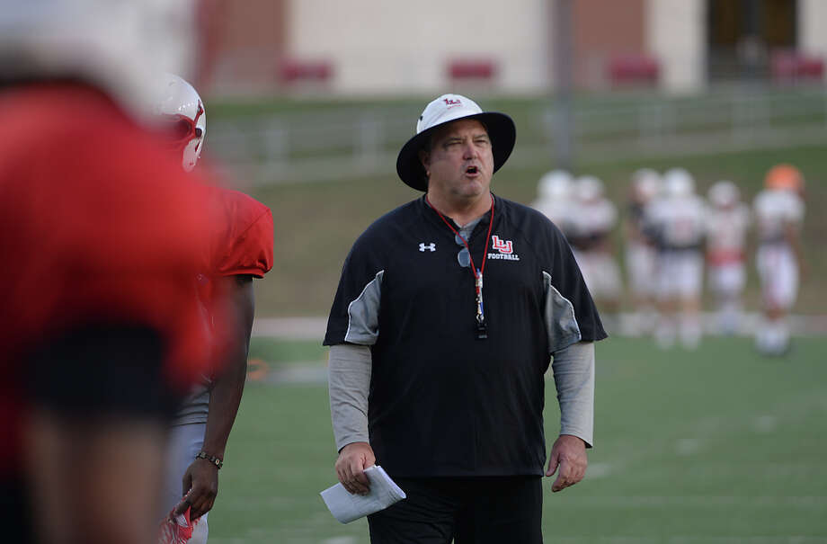 Lamar Cardinals defensive coordinator Craig McGallion shouts advice as he observes the defense run drills during Wednesday's practice. Photo taken Wednesday, August 26, 2015 Kim Brent/The Enterprise Photo: Kim Brent / Beaumont Enterprise