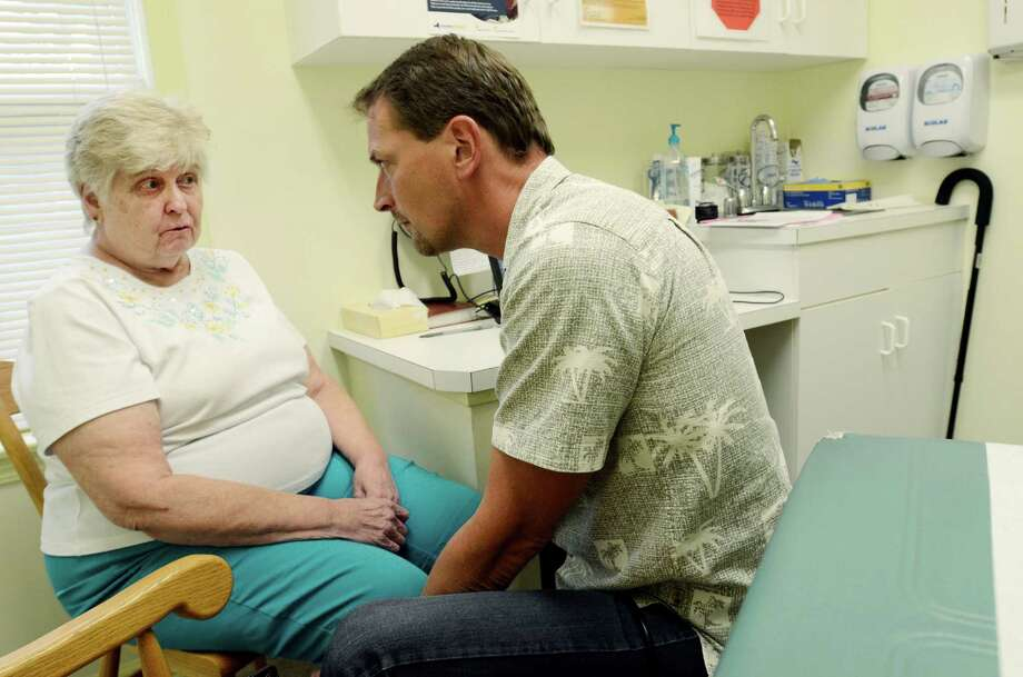 Dr. Joseph Hinterberger discusses end-of-life care with Mary Ann Zebrowski at his practice in Dundee, N.Y., July 23, 2014. Once famously decried as death panels, the practice of doctors talking to patients about end-of-life care is making a comeback. (Heather Ainsworth/The New York Times) Photo: HEATHER AINSWORTH, STR / NYTNS