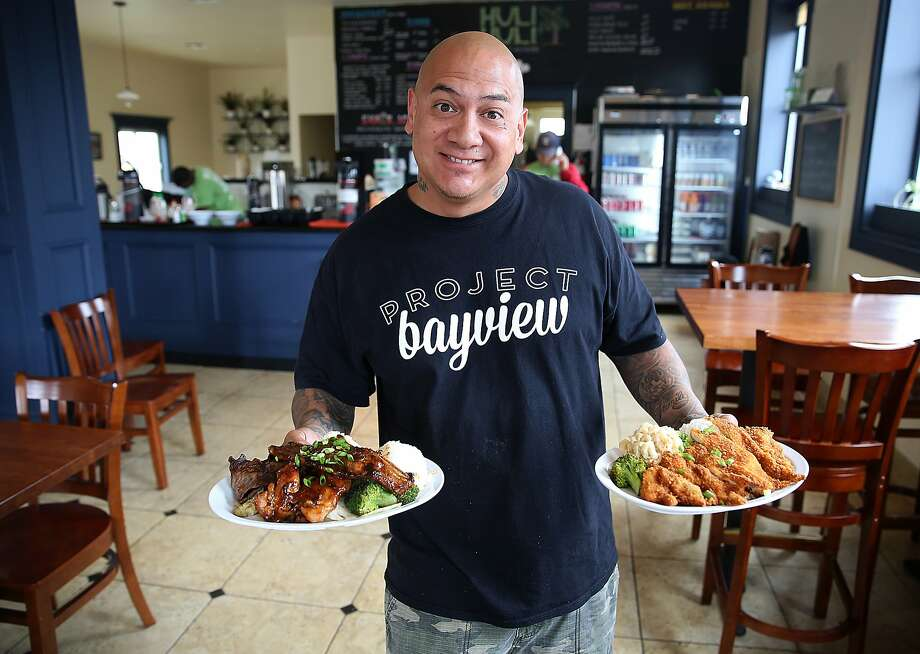 Director, pastor and manager Shawn Gordon shows some of the offerings at HuliHuli Hawaiian Grill in the Bayview-Hunters Point neighborhood of S.F. Photo: Liz Hafalia, The Chronicle