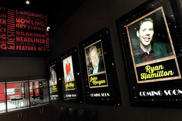 Posters in the bar area at the Funny Bone Comedy Club on Thursday, Aug. 27, 2015, at Crossgates Mall in Guilderland, N.Y. (Cindy Schultz / Times Union) Photo: Cindy Schultz / 00033157A