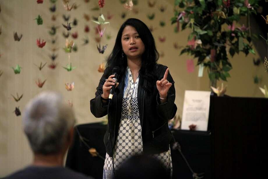 "Akiko Aspillaga of Aspire performs a spoken-word piece at ""Define Undocumented: Flip the Script."" Photo: Connor Radnovich, The Chronicle"