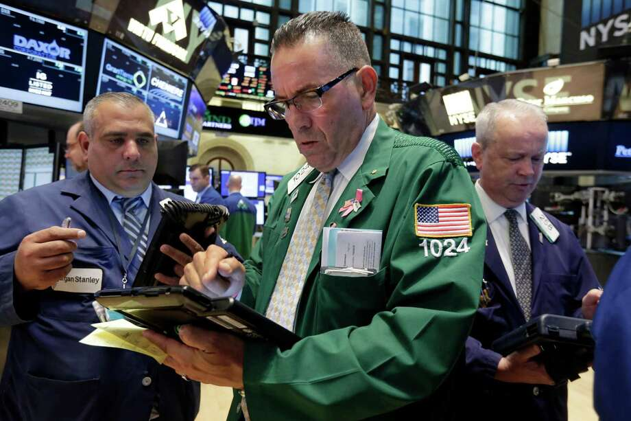 John Yaccarine, center, works with fellow traders on the floor of the New York Stock Exchange Thursday, Aug. 27, 2015. U.S. stocks are opening higher after China's main stock index logged its biggest gain in eight weeks. A report also showed that the U.S. economy expanded at a much faster pace than previously estimated. (AP Photo/Richard Drew) ORG XMIT: NYRD105 Photo: Richard Drew / AP